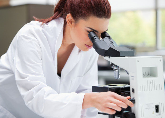 young-scientist-looking-into-microscope_13339-229428.jpg